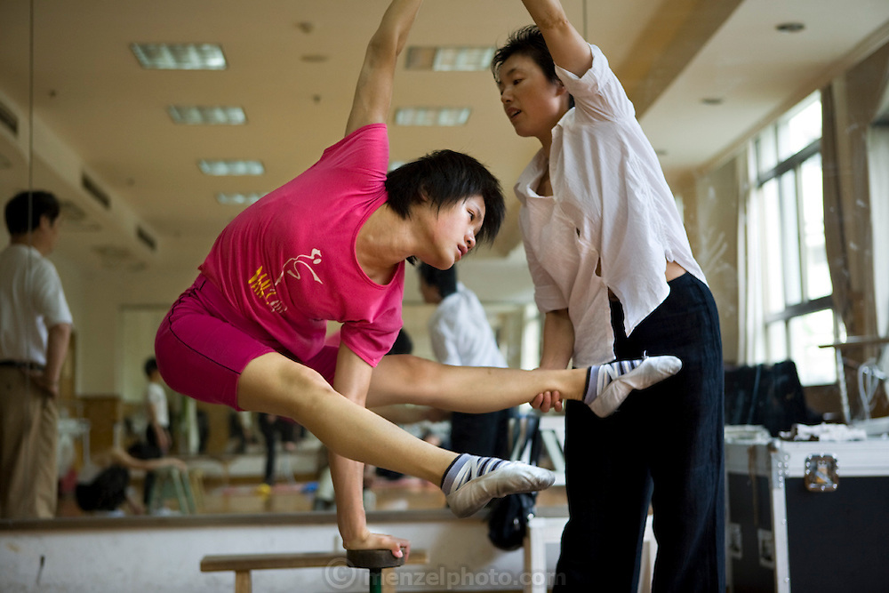 Cao Xiaoli, a professional acrobat, practices at Shanghai Circus World in Shanghai, China.  (Featured in the book What I Eat: Around the World in 80 Diets.) The caloric value of her day's worth of food on a typical day in June was 1700 kcals.  She is 16 years of age; 5 feet, 2 inches tall; and 99 pounds.  Cao Xiaoli lives in  a room with nine other girls. She started her career as a child, performing with a regional troupe in her home province of Anhui. Now she practices five hours a day, attends school with the other members of her troupe, and performs seven days a week. She says what she likes best about being an acrobat is the crowd's reaction when she does something seemingly dangerous. MODEL RELEASED.
