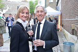 JEFFREY & ANNA COHEN at a private view in aid of Chickenshed of Julian Schnabel's first UK solo show of paintings for 15 years entitled 'Every Angel Has A Dark Side' held at the Dairy Art Centre, 7a Wakefield Street, Bloomsbury, London on 24th April 2014.