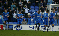 Photo: Chris Brunskill. Wigan Athletic v Ipswich Town. Coca-Cola Championship. 05/03/2005. Nathan Ellington of Wigan celebrates with his teammates after scoring the opening goal of the game from the penalty spot.