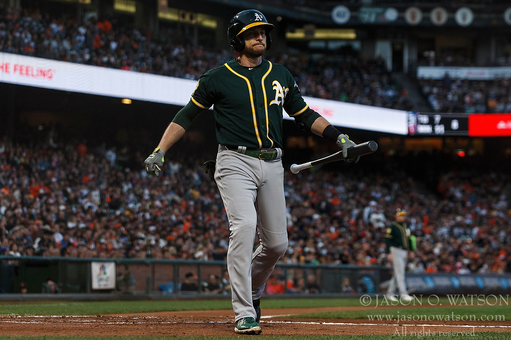 SAN FRANCISCO, CA - JULY 13: Jed Lowrie #8 of the Oakland Athletics returns to the dugout after striking out against the San Francisco Giants during the fourth inning at AT&T Park on July 13, 2018 in San Francisco, California. The San Francisco Giants defeated the Oakland Athletics 7-1. (Photo by Jason O. Watson/Getty Images) *** Local Caption *** Jed Lowrie
