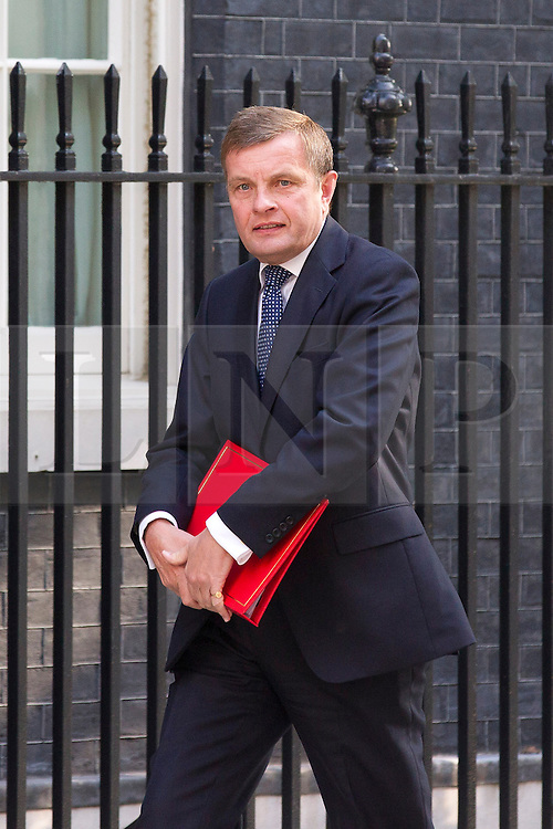 """© Licensed to London News Pictures. 29/08/2013. London, UK. The Welsh Secretary David Jones arrives for a meeting of the British cabinet on Downing Street in London today (29/08/2013) as a recalled British Parliament prepares to debate the possibility of """"direct"""" military action over recent reports an alleged chemical weapons attack in Syria. Photo credit: Matt Cetti-Roberts/LNP"""