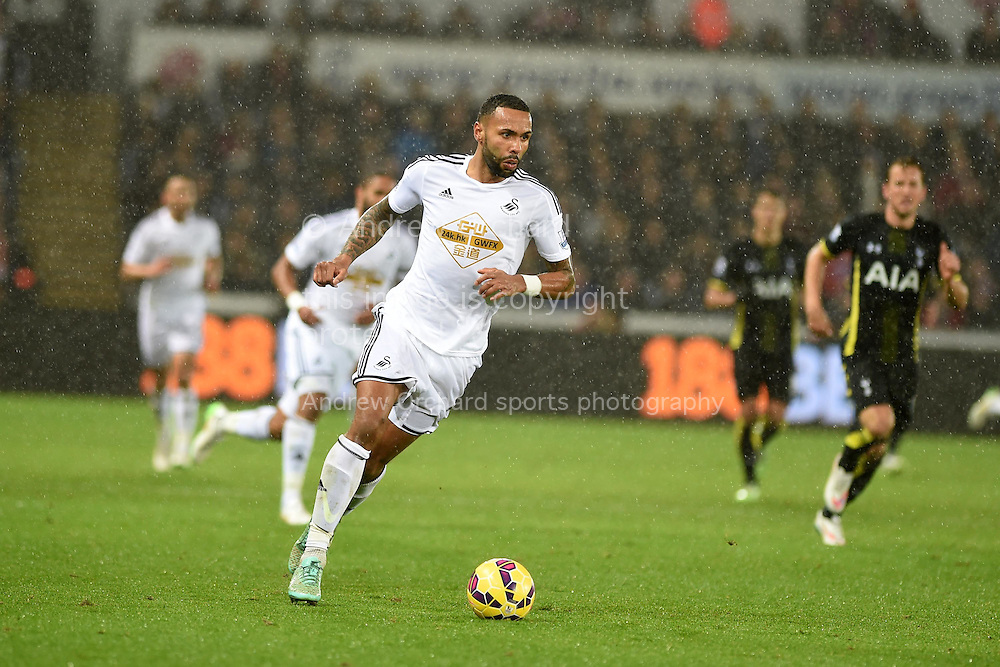 Kyle Bartley of Swansea city in action.Barclays Premier League match, Swansea city v Tottenham Hotspur at the Liberty Stadium in Swansea, South Wales on Sunday 14th December 2014<br /> pic by Andrew Orchard, Andrew Orchard sports photography.