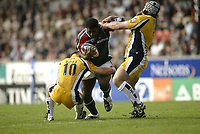 Photo Aidan Ellis.<br />Leicester Tigers v Leeds Tykes.<br />Zurich Premiership.<br />11/09/2004.<br />Leicester's Seru Rabeni is tackled by Leeds Gordon Ross and Matt Cardey