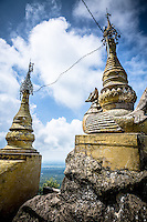 With a temple at the top the stunning Mt Popa in Burma jutts from the surrounding flat terrain.