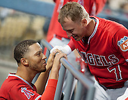 The Angels' Andrelton Simmons and Cliff Pennington share a story during their Freeway Series game Friday night at Dodger Stadium.<br /> <br /> <br /> ///ADDITIONAL INFO:   <br /> <br /> freeway.0402.kjs  ---  Photo by KEVIN SULLIVAN / Orange County Register  --  4/1/16<br /> <br /> The Los Angeles Angels take on the Los Angeles Dodgers at Dodger Stadium during the Freeway Series Friday.<br /> <br /> <br />  4/1/16