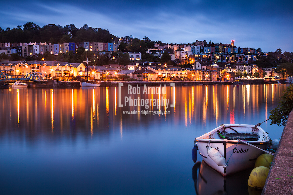 A view of Hotwells in Bristol at dusk. Cabot Tower can be seen flashing it's red lights on top of Brandon Hill in the distance.