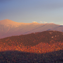Twin Mountain, NH. The view east to Mount Washington, Mt. Monroe, and Mt. Eisenhower from Middle Sugarloaf in the White Mountain National Forest.  Fall.