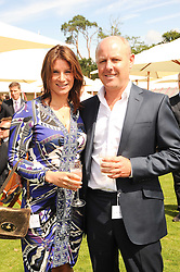The HON.SELINA TOLLEMACHE and her fiance JAMES HOPKINS at the Cartier International Polo at Guards Polo Club, Windsor Great Park, Berkshire on 25th July 2010.