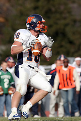 10 November 2007: Kyle Bradley in the pocket looking down field for a receiver.  This game between the Wheaton College Thunder and the Illinois Wesleyan University Titans was for a share of the CCIW Championship and was played at Wilder Field on the campus of Illinois Wesleyan University in Bloomington Illinois.