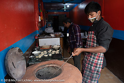 Making bread in a Tandoori oven on the streets of Kathmandu after our Himalayan motorcycling adventure, Nepal. Friday, November 16, 2018. Photography ©2018 Michael Lichter.