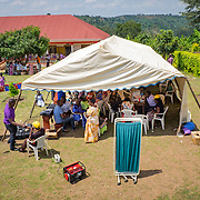 CAPTION: Overview of an event held by SignHealth Uganda at Kakunyu Inclusive Nursery and Primary School in the village of Kakunyu. During these events, SignHealth puts on cultural shows and musical performances, while conducting ear screenings and HIV tests, in order to attract more locals to the programme. They also stage dramas that try to portray scenarios in which hearing impaired people express the challenges and discrimination they face.  LOCATION: Kakunyu Inclusive Nursery and Primary School, Kakunyu Village, near Masaka city, Lweongo District, Central Region, Uganda. INDIVIDUAL(S) PHOTOGRAPHED: N/A.