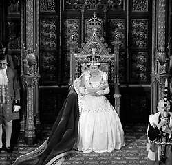 File photo dated 21/04/66 of Queen Elizabeth II delivering her speech from the throne in the House of Lords at the State Opening of Parliament. The Queen is wearing the same Peau De Soie taffeta dress by Norman Hartnell that was worn by Princess Beatrice at her wedding to Edoardo Mapelli Mozzi on Friday.