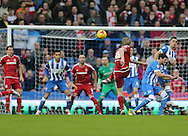 Middlesbrough FC midfielder Adam Clayton shoots during the Sky Bet Championship match between Brighton and Hove Albion and Middlesbrough at the American Express Community Stadium, Brighton and Hove, England on 19 December 2015.