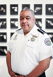 02 October 2014. Jonathan Ferrara Gallery, New Orleans, Louisiana. <br /> 'NOPD police chief Michael S. Harrison attends the opening of 'Guns In The Hands Of Artists' art show at the Jonathan Ferrara Gallery. The show brings together over 30 internationally acclaimed artists who took parts from 190 destroyed weapons acquired by the New Orleans Police department  and converted them into art.  <br /> Photo; Charlie Varley/varleypix.com