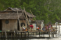 A family at their house in Kabilo Village..This is an area of Waigeo Island visited by Alfred Russel Wallace in the 1850's.