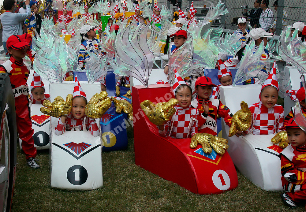 Pre-race show with children before the 2005 Chinese Grand Prix in Shanghai. Photo: Grand Prix Photo.