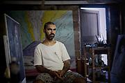 Daniel Boyd, Artist -Painter and Video in his Garage Studio.