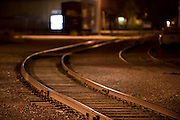 A railroad track winds it s way through an empty railroad yard at night. Taken with a shallow depth of field. Missoula Photographer, Missoula Photographers, Montana Pictures, Montana Photos, Photos of Montana
