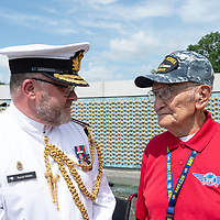 Embassy representative Commodore Daniel Gibbs of New Zealand, left, talks with World War II and Korean War veteran Lawrence Talamante, 94, after the wreath laying ceremony, at the WWII memorial in Washington D.C. Jun. 06.