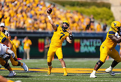 Oct 6, 2018; Morgantown, WV, USA; West Virginia Mountaineers quarterback Will Grier (7) throws a pass during the first quarter against the Kansas Jayhawks at Mountaineer Field at Milan Puskar Stadium. Mandatory Credit: Ben Queen-USA TODAY Sports