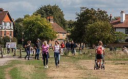 "© Licensed to London News Pictures. 12/09/2020. Surrey, UK. Walkers and picnickers enjoy the glorious sunshine on Wimbledon Common in South West London this afternoon before the ""Rule of 6"" comes into force on Monday as weather experts announce a 6 day mini heatwave in the South East of England this week with highs in excess of 29c. Prime Minister Boris Johnson is already under pressure after he announced on Friday that gatherings of more than six people will be banned from Monday in the hope of reducing the coronavirus R number. The Rule of Six as it is known, has already become unpopular with MPs and large families. Photo credit: Alex Lentati/LNP"