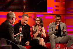 (left to right) Host Graham Norton, Tom Hanks, Maisie Williams, and Anthony Joshua during filming of the Graham Norton Show at The London Studios, to be aired on BBC One on Friday.