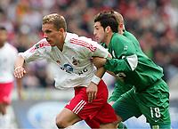v.l. Lukas Podolski, Facundo Quiroga Wolfsburg<br />Bundesliga 1.FC Koeln - VfL Wolfsburg