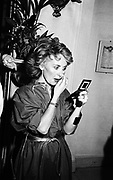 Lulu checking her makeup. Private view of Patrick Lichfield photos. Ritz. October 1981. © Copyright Photograph by Dafydd Jones 66 Stockwell Park Rd. London SW9 0DA Tel 020 7733 0108 www.dafjones.com