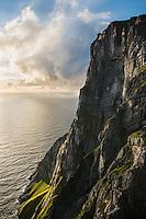 Steep cliffs of Ryten rise from sea, Lofoten Islands, Norway