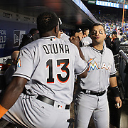 NEW YORK, NEW YORK - APRIL 11: Martin Prado, (right), and Marcell Ozuna, Miami Marlins, in the dugout during the Miami Marlins Vs New York Mets MLB regular season ball game at Citi Field on April 11, 2016 in New York City. (Photo by Tim Clayton/Corbis via Getty Images)