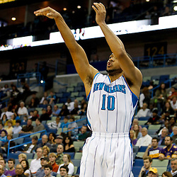 December 21, 2011; New Orleans, LA, USA; New Orleans Hornets shooting guard Eric Gordon (10) shoots against the Memphis Grizzlies during the first quarter of a game at the New Orleans Arena.   Mandatory Credit: Derick E. Hingle-US PRESSWIRE