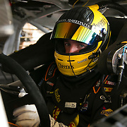 Driver Ty Dillon is seen in his car in the garage area during the last practice session for the 57th Annual NASCAR Daytona 500 race at Daytona International Speedway on Saturday, February 21, 2015 in Daytona Beach, Florida.  (AP Photo/Alex Menendez)
