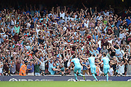 West Ham United fans celebrate as Mauro Zarate of West Ham United celebrates scoring his sides second goal of the game to make it 0-2. Barclays Premier League, Arsenal v West Ham Utd at the Emirates Stadium in London on Sunday 9th August 2015.<br /> pic by John Patrick Fletcher, Andrew Orchard sports photography.