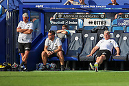 AFC Wimbledon manager Glyn Hodges sat back in chair after Plymouth goal during the EFL Sky Bet League 1 match between AFC Wimbledon and Plymouth Argyle at the Kiyan Prince Foundation Stadium, London, England on 19 September 2020.