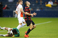 13 December 2015: Stanford's Jordan Morris (right) reacts after being beaten to the ball by Clemson's Andrew Tarbell (left). The Clemson University Tigers played the Stanford University Cardinal at Sporting Park in Kansas City, Kansas in the 2015 NCAA Division I Men's College Cup championship match. Stanford won the game 4-0.
