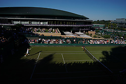 Stefanos Tsitsipas in action against Gregoire Barrere on day one of the Wimbledon Championships at the All England Lawn Tennis and Croquet Club, Wimbledon.