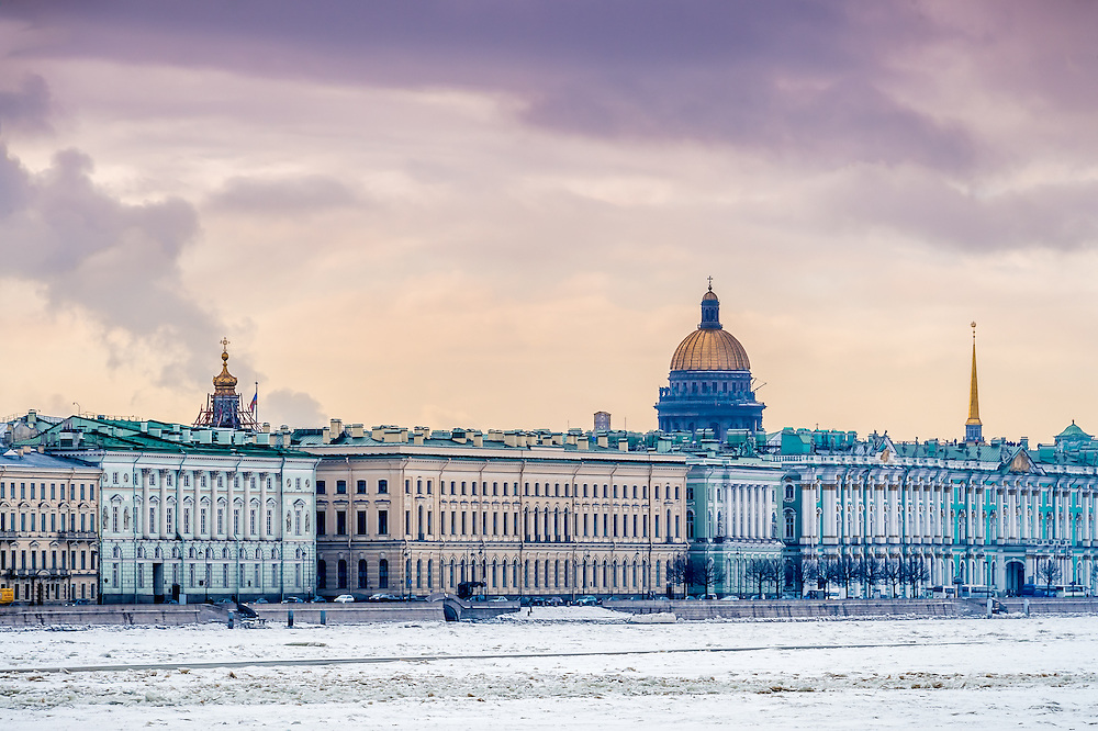 View of Saint Petersburg during winter from the banks of the Neva river with St. Isaac's dome behind.