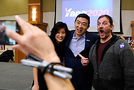 Democratic 2020 U.S. presidential candidate and entrepreneur Andrew Yang poses for a selfie with his wife Evelyn after speaking at a town hall meeting in Sioux City, Iowa, January 27, 2020.     REUTERS/Rick Wilking
