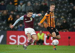 Aston Villa's Jack Grealish fires a shot as Hull City's Markus Henriksen challenges