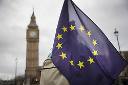 © Licensed to London News Pictures. 29/03/2017. London, UK. A protestor carries an EU and Union flag in sight of Big Ben and Parliament on the day that Prime Minister Theresa May will trigger Article 50 to start the process of the UK's withdrawal from the European Union.  Photo credit: Peter Macdiarmid/LNP