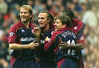 Boudewijn Zenden (Middlesbrough) celebrates scoring the 1st goal with team mates Gaizka Mendieta and Juninho. Aston Villa v Middlesbrough. 8/11/2003. Credit : Colorsport/Andrew Cowie.