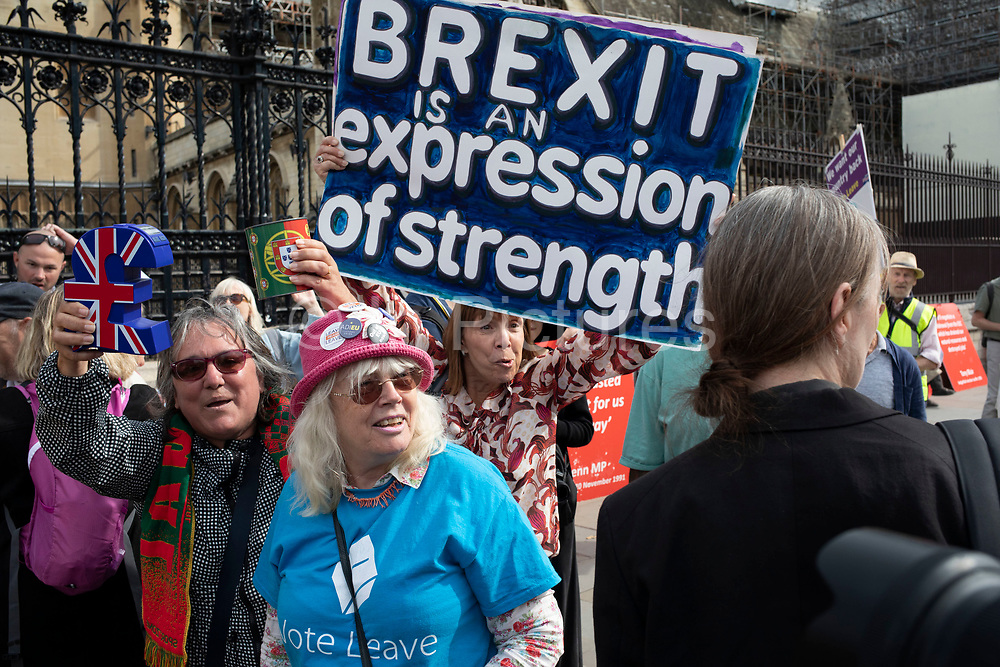 Anti Brexit protester is berated by Leave protesters in a fierce debate in Westminster on the day after Parliament voted to take control of Parliamentary proceedings and prior to a vote on a bill to prevent the UK leaving the EU without a deal at the end of October, on 5th September 2019 in London, England, United Kingdom. Yesterday Prime Minister Boris Johnson faced a showdown after he threatened rebel Conservative MPs who vote against him with deselection, and vowed to aim for a snap general election if MPs succeed in a bid to take control of parliamentary proceedings to allow them to discuss legislation to block a no-deal Brexit.