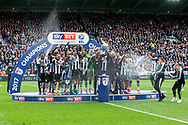 Newcastle United players celebrate as Newcastle United defender Jamaal Lascelles (#6) holds up the EFL Sky Bet Championship Trophy following the EFL Sky Bet Championship match between Newcastle United and Barnsley at St. James's Park, Newcastle, England on 7 May 2017. Photo by Craig Doyle.