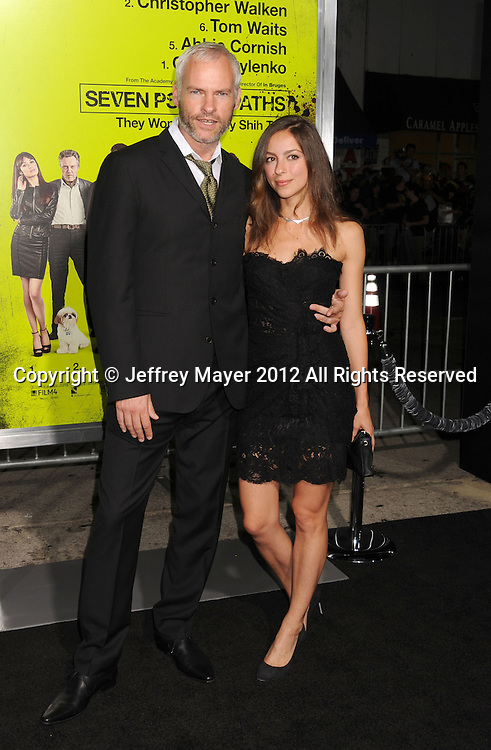 WESTWOOD, CA - OCTOBER 01: Martin McDonagh and guest arrive at the Los Angeles premiere of 'Seven Psychopaths' at Mann Bruin Theatre on October 1, 2012 in Westwood, California.