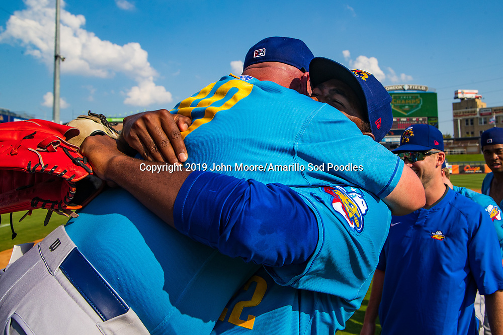 Amarillo Sod Poodles Manager Phillip Wellman and Amarillo Sod Poodles pitcher Dauris Valdez (22) celebrates after the Sod Poodles won against the Tulsa Drillers during the Texas League Championship on Sunday, Sept. 15, 2019, at OneOK Field in Tulsa, Oklahoma. [Photo by John Moore/Amarillo Sod Poodles]