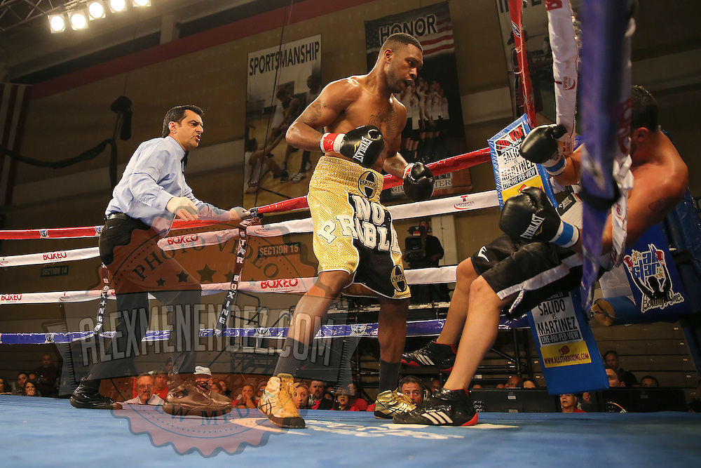 KISSIMMEE, FL - MARCH 06:  Robert Burwell (R) falls through the ropes after a punch by Nathaniel Gallimore during the Telemundo Boxeo boxing match at the Kissimmee Civic Center on March 6, 2015 in Kissimmee, Florida. Gallimore won the bout by TKO.  (Photo by Alex Menendez/Getty Images) *** Local Caption *** Nathaniel Gallimore; Robert Burwell