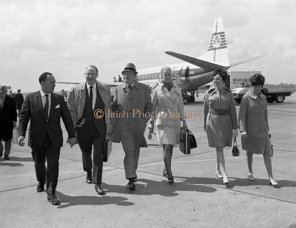 """Bob Hope, accompanied by Lady Caroline Townsend (his Press Agent in London), prepares for his whirlwind visit to Ireland as he steps from the plane at Dublin Airport. He is in Dublin to appear at the Savoy Cinema where his film """"8 on the Run"""" has opened..18.05.1968"""