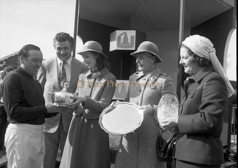 "Irish Distillers Grand National at Fairyhouse.  (M66)..1979..16.04.1979..04.16.1979..16th April 1979..The Irish Distillers Grand National was run today at Fairyhouse Racecourse, Co Meath.The race over 3.5miles is valued at £20,000. the winning trainer will also receive the Tom Dreaper,Perpetual Trophy which will be presented by Mrs Betty Dreaper..Picture of winning owner and rider of ""Tied Cottage"", Mr Anthony Robinson accepting his trophy from Mrs Michael Kennedy,also pictured are Mr Richard Burrows,MD,Irish Distillers Ltd, Mrs Dreaper and Mrs Joan Moore, wife of the winning trainer,Mr D L Moore."