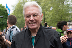© Licensed to London News Pictures. 15/05/2021. London, UK. DAVID ICKE joins anti-vaccination and anti-lockdown protesters in an organised demonstration in central London. It has been over a year since the UK went into lockdown due to the rise in Covid-19 cases. Photo credit: Ray Tang/LNP