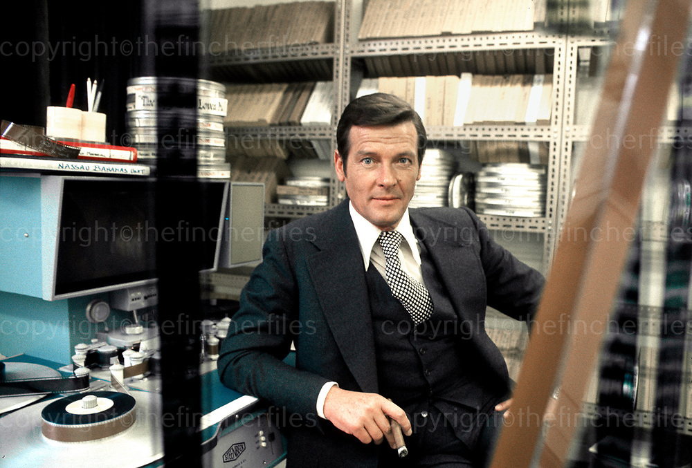 Sir Roger Moore visits the editing suite at Pinewood Studios during filming of 'The Spy Who Loved Me' 1977.